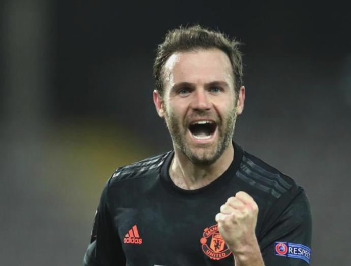 Juan Mata embracing Manchester United Old Trafford