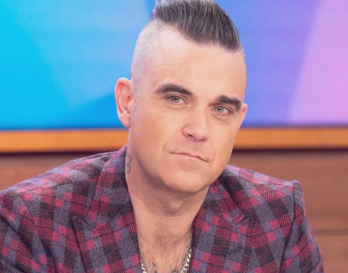 Robbie Williams writes moving tribute friend's took